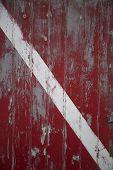 image of martha  - Weathered red door with white stripe in Memensha Massachusetts on Martha - JPG