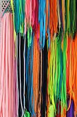 picture of shoes colorful  - Fashion style colorful shoe laces on wall - JPG
