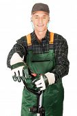 stock photo of electric trimmer  - Experienced gardener with trimmer and ear protectors - JPG