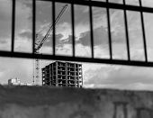 stock photo of construction crane  - Newly constructed high - JPG
