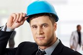 picture of hard_hat  - Happy handsome businessman with blue hard hat - JPG