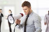foto of shout  - Handsome businessman shouting through megaphone - JPG