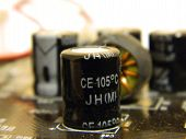 picture of condensation  - Motherboard condenser from a very old motherboard AGP - JPG