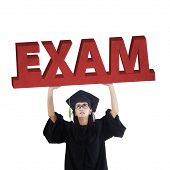 picture of exams  - Female graduate student standing in the studio while holding an exam text symbolizing an exam pressure - JPG