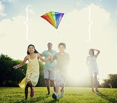 foto of kites  - Family Playing Kite Summer Outdoors Leisure Concept - JPG