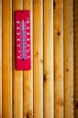 picture of lumber  - Thermometer indicates high temperature on wood texture with vertical lumbers - JPG