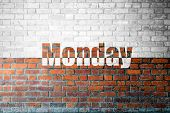 foto of monday  - Red Brick wall texture background with a word Monday - JPG