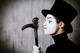 stock photo of pantomime  - Portrait in profile of a male mime artist performing different emotions - JPG