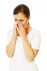 pic of sinuses  - Young woman with sinuses pain - JPG