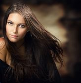 stock photo of brunette hair  - Beautiful Young Woman - JPG