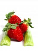 stock photo of ceres  - fresh green cerely stem with red strawberry - JPG