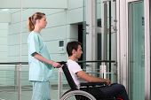 stock photo of crippled  - Young cripple and medical assistant - JPG