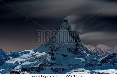 Snow Capped Mountain Top Against