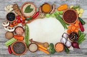 Healthy diet food background border on parchment paper and rustic wood. Super foods concept high in  poster