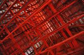 picture of rafters  - Abstract interior view of red barn rafters - JPG