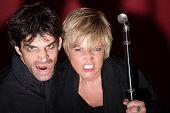 stock photo of scepter  - Evil Caucasian fortuneteller couple hold a scepter - JPG