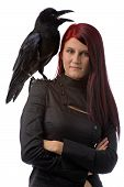 pic of red hair  - young woman looking like a witch in black clothes with big raven on her shoulder isolated on white - JPG