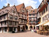 stock photo of alsatian  - Picturesque square in the Alsatian city of Colmar - JPG