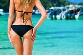 Sexy Woman Buttocks On Tropical Beach Background Near Ocean. Close Up Outdoor Shot Of Young Woman In poster