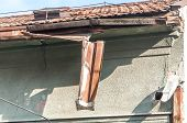 Broken And Damaged Old Rusty Rain Gutter On The Roof Of The House poster