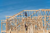 Close-up Two-story Stick Built Home With Building Contractor Carpenter In Texas, Usa poster