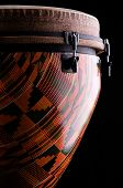picture of congas  - An orange African or Latin Djembe conga drum isolated on black background in the vertical for - JPG