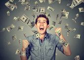 Happy Young Man Screaming Super Excited. Portrait Ecstatic Guy Celebrates Success Under Money Rain F poster