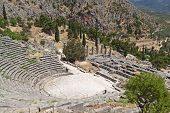 stock photo of oracle  - Temple of Apollo and the theater at Delphi oracle archaeological site in Greece - JPG