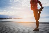 Running Stretching Before Running. Athlete On The Seacoast. poster