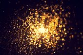 Bokeh Of Glitter Lights Black Background, Shining Defocused Abstract Lights. Gold Bubble Lights Or S poster