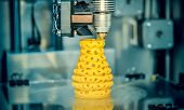3d Printer Printing Objects Yellow Form Closeup. Modern Technical 3d Printing. poster