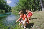 Siblings Summer Recreation Activity Outdoor Game On Italian Tirino River Bank In Sunny Day poster