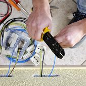 Electrician Technician At Work Uses The Wire Stripper In A Residential Electrical Installation poster