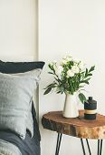 Trendy Scandinavian Style Interior Shot. Bedroom With Washed Linen Grey Pillows And Wooden Nightstan poster