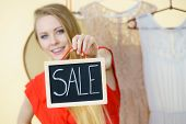 Woman In Clothes Shop Store Holding Black Board With Sign Sale, Picking Summer Perfect Outfit, Dress poster
