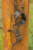 Old Fashioned, Vintage Shackles Hanging On The Log. The Picture Is Reflective Of Incarceration, Jail poster