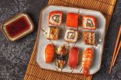 Sushi Set: Sushi And Sushi Rolls On Plate, Top View. poster