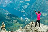 Tourism Vacation And Travel. Female Tourist Taking Photo With Camera, Enjoying Geiranger Fjord And M poster