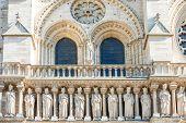 Architectural Details On Facade Of Famous Cathedral Notre-dame De Paris. Paris, France poster