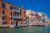 View Of Venice From The Grand Canal. Venetian Old Colorful Buildings Against Blue Sky. Boat Trip Thr poster