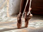 closeup of ballerina feet in pointe shoes poster