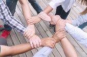 Teamwork Connection Success Concept. Group Of People Holding Hands Circle Together In The Park. Huma poster
