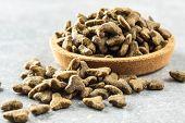 Dry pet food. Kibble dog or cat food in bowl. poster