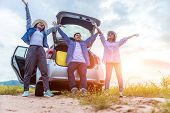 Happy Young Asian Friend Sitting And Standing Behind The Car On Vacation Holiday With Travel Road Tr poster