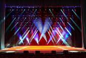 Illuminated Empty Concert Stage With Multicolor Light And Stage Fog poster