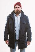 Stylish And Comfortable. Man Bearded Hipster Posing Confidently In Warm Black Jacket Or Parka. Hipst poster