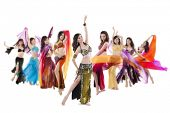 Belly dancer troupe posing on white background