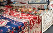 Market Stall Specializing In The Sale Of Precious Handmade Oriental Rugs poster