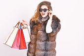 Buy With Discount On Black Friday. Shopping Or Birthday Gift. Girl Wear Sunglasses And Furry Coat Sh poster
