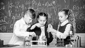 Little Kids Learn Chemistry In School Lab. Students Do Biology Experiments With Microscope. Lab Micr poster
